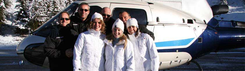 About Whitetracks Helicopters - Picture: Helicopter Pilots and Staff next to a Eurocopter AS350 single engine helicopter